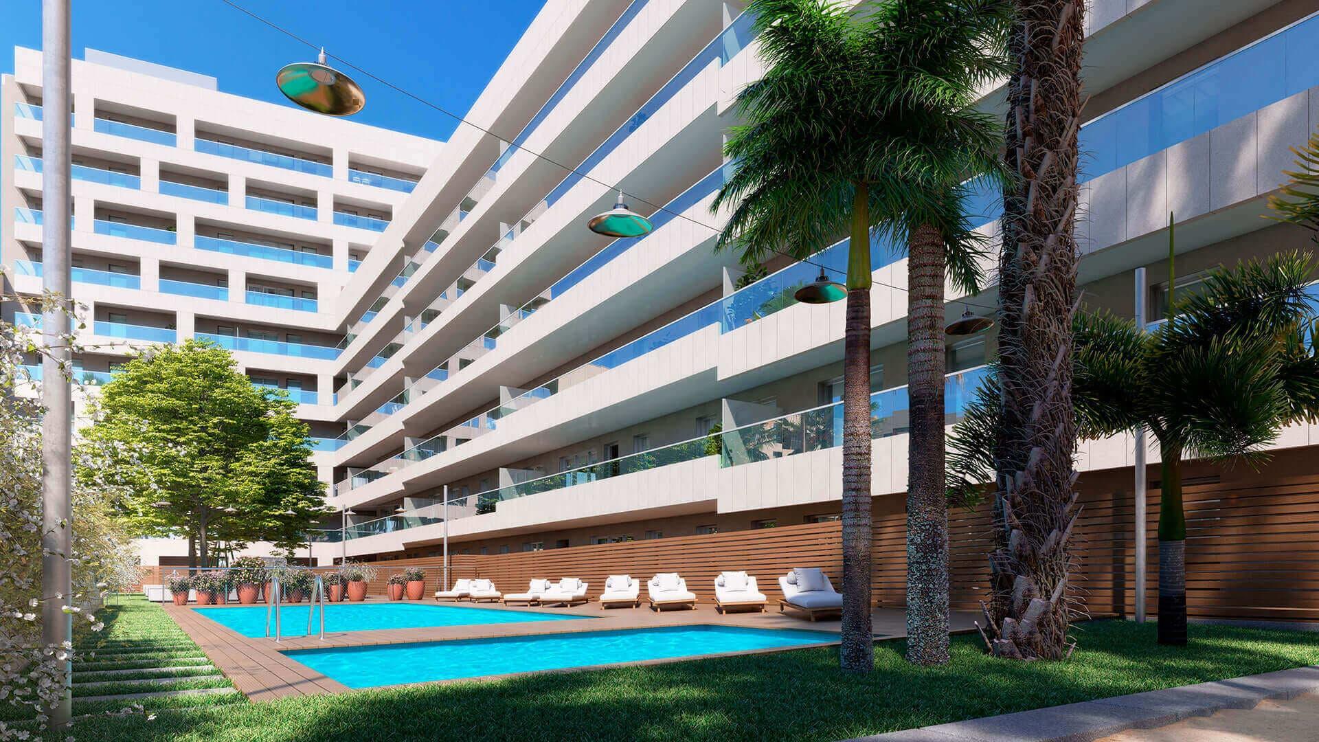 Vista zonas comunes piscina jardín Nova Sagrega