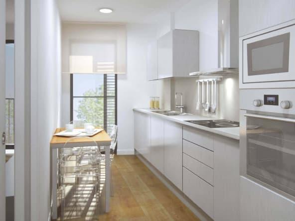 Vista interior cocina espaciosa y luminosa Odeón Residencial